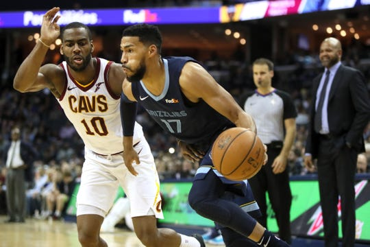 Grizzlies guard Garrett Temple drives past Cavaliers defender Alec Burks during a game in late December.