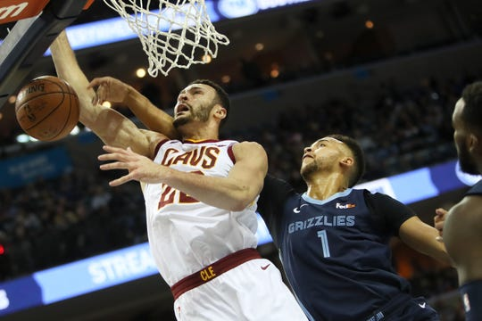 Memphis Grizzlies guard Kyle Anderson blocks a shot by Cleveland Cavaliers forward Larry Nance Jr. during their game at the FedExForum on Wednesday, Dec. 26, 2018.