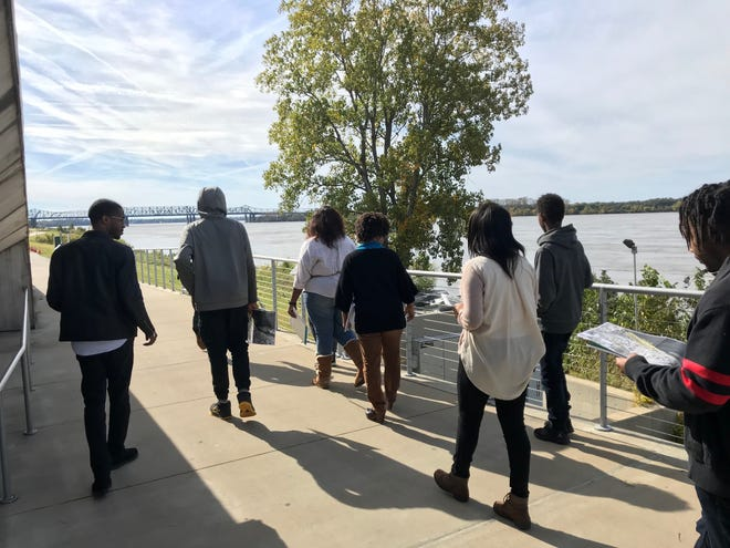 Douglass High School and Knowledge Quest students walk along Tom Lee Park for a youth design program that will let them shape the future of the park.