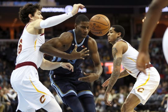 Grizzlies forward Jaren Jackson Jr. is stripped of the ball by Cavaliers defender Cedi Osman on Dec. 26.
