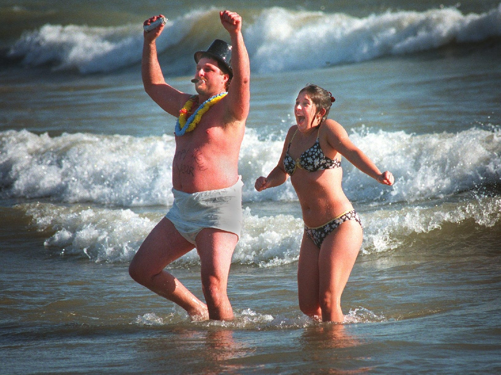 Dave Finses and Dana Smith have different perspectives on the icy water of Lake Michigan during the Polar Bear Plunge at Bradford Beach on Jan. 1, 1998.