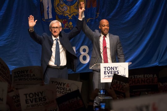Democratic candidate for governor Tony Evers (left) and lieutenant governor candidate Mandela Barnes greet supporters at their watch party Nov. 7 at the Orpheum Theater in Madison.