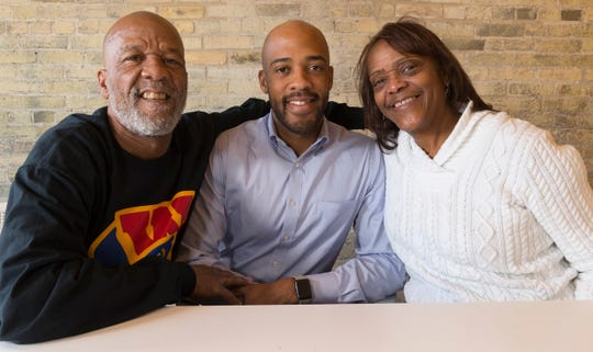 Incoming Lt. Gov.-elect Mandela Barnes  (center) is shown with his parents, Jesse and LaJuan Barnes, in Milwaukee.