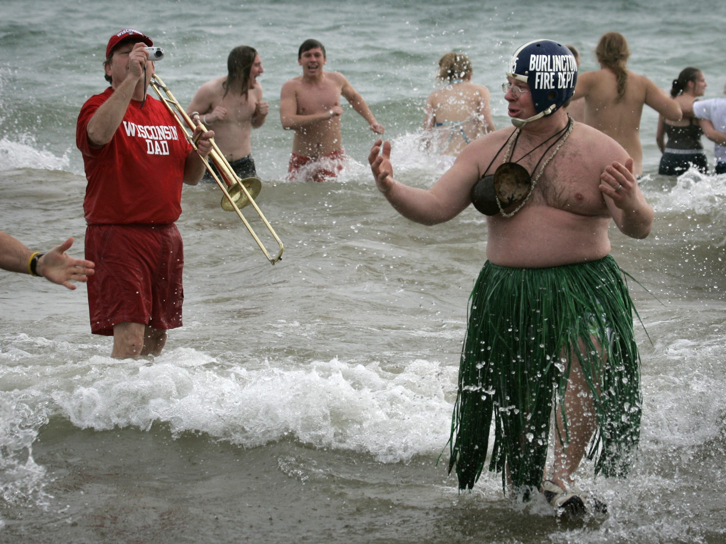 David Walesa of Burlington appears ready for a luau as he joined hundreds of other adventurous souls with a dive into the icy waters of Lake Michigan during the annual Polar Bear Plunge at Bradford Beach on New Year's Day in 2006.