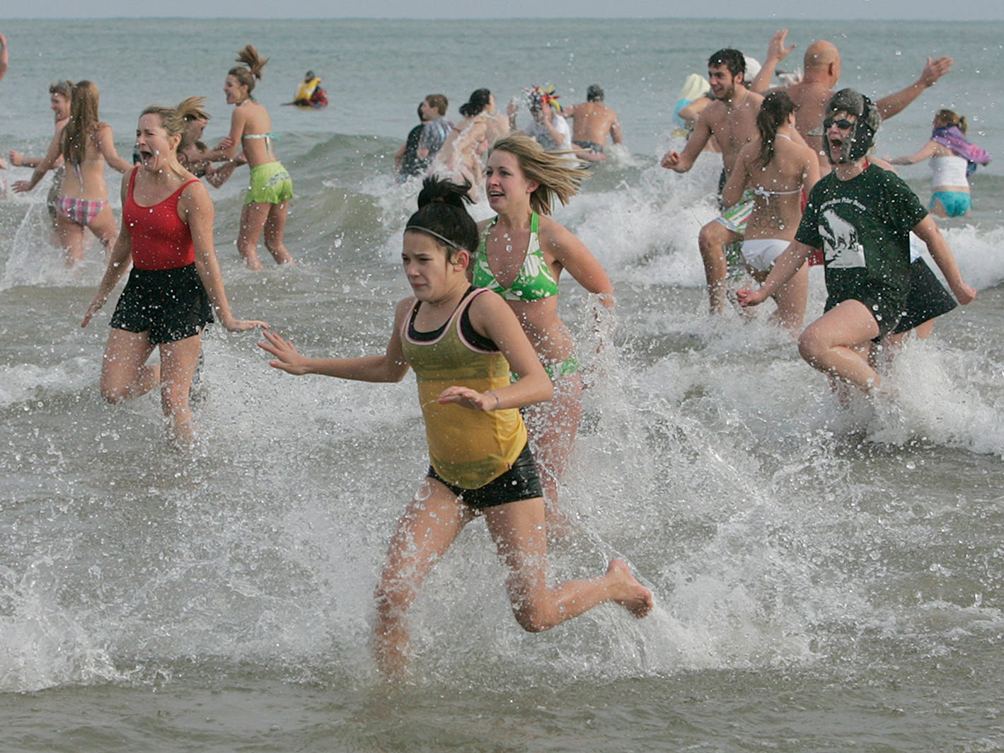 A wave of participants races back to shore during the annual Polar Bear Plunge at Bradford Beach on Jan. 2, 2008.