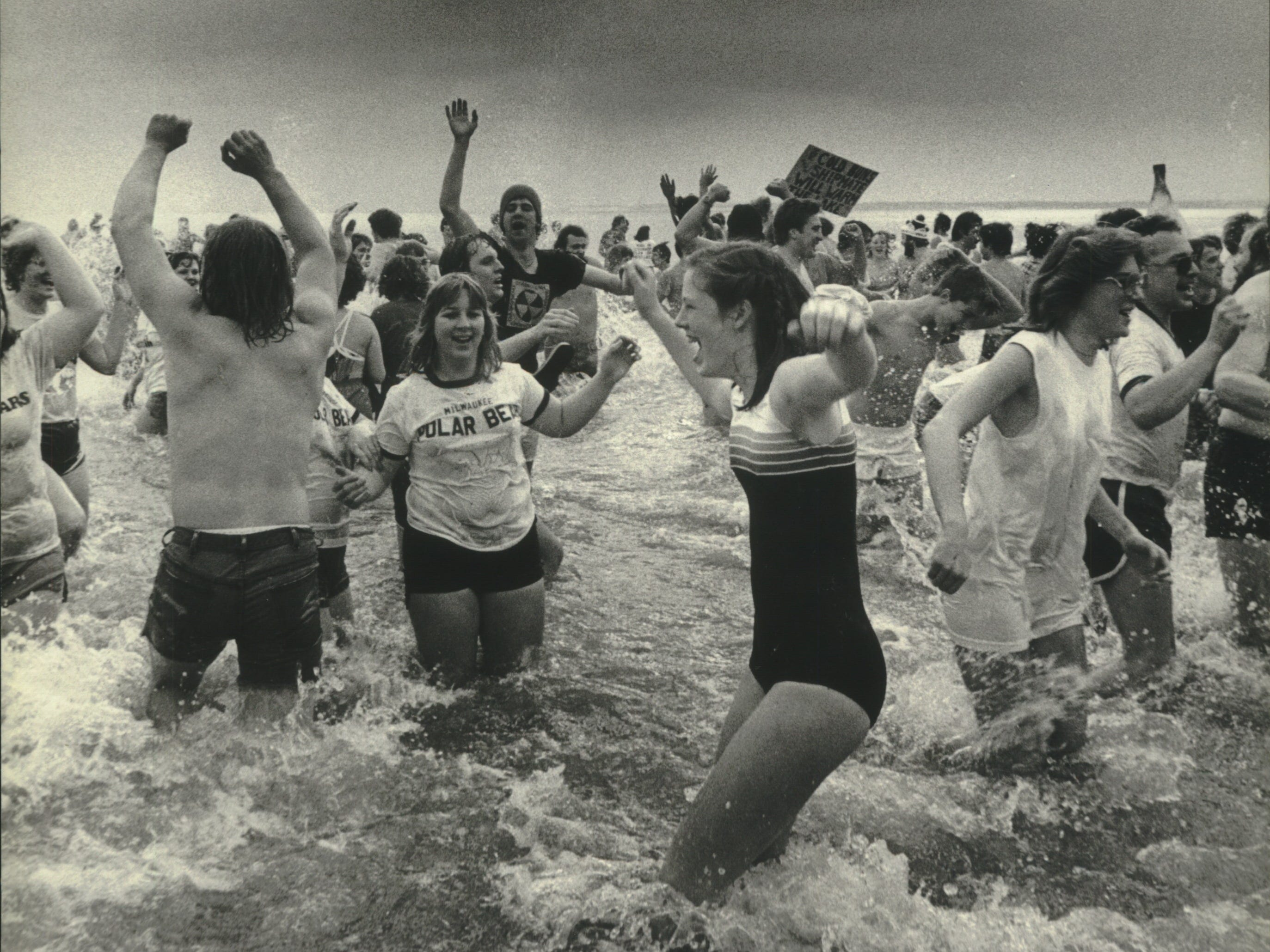 You can't tell from the photo, but it's 30 degrees out and the water is just 35 as members of the Milwaukee Polar Bear Club dip into Lake Michigan at Bradford Beach on Jan. 1, 1981. This photo was published on Jan. 2, 1981, in The Milwaukee Journal.