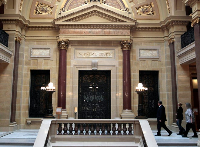 Wisconsin Supreme Court justices heard oral arguments on pair of far-reaching environmental lawsuits, concluding they hinge on whether a law Republicans passed in 2011 limiting agencies' powers trumps the Department of Natural Resources' broad authority to protect Wisconsin's waters.