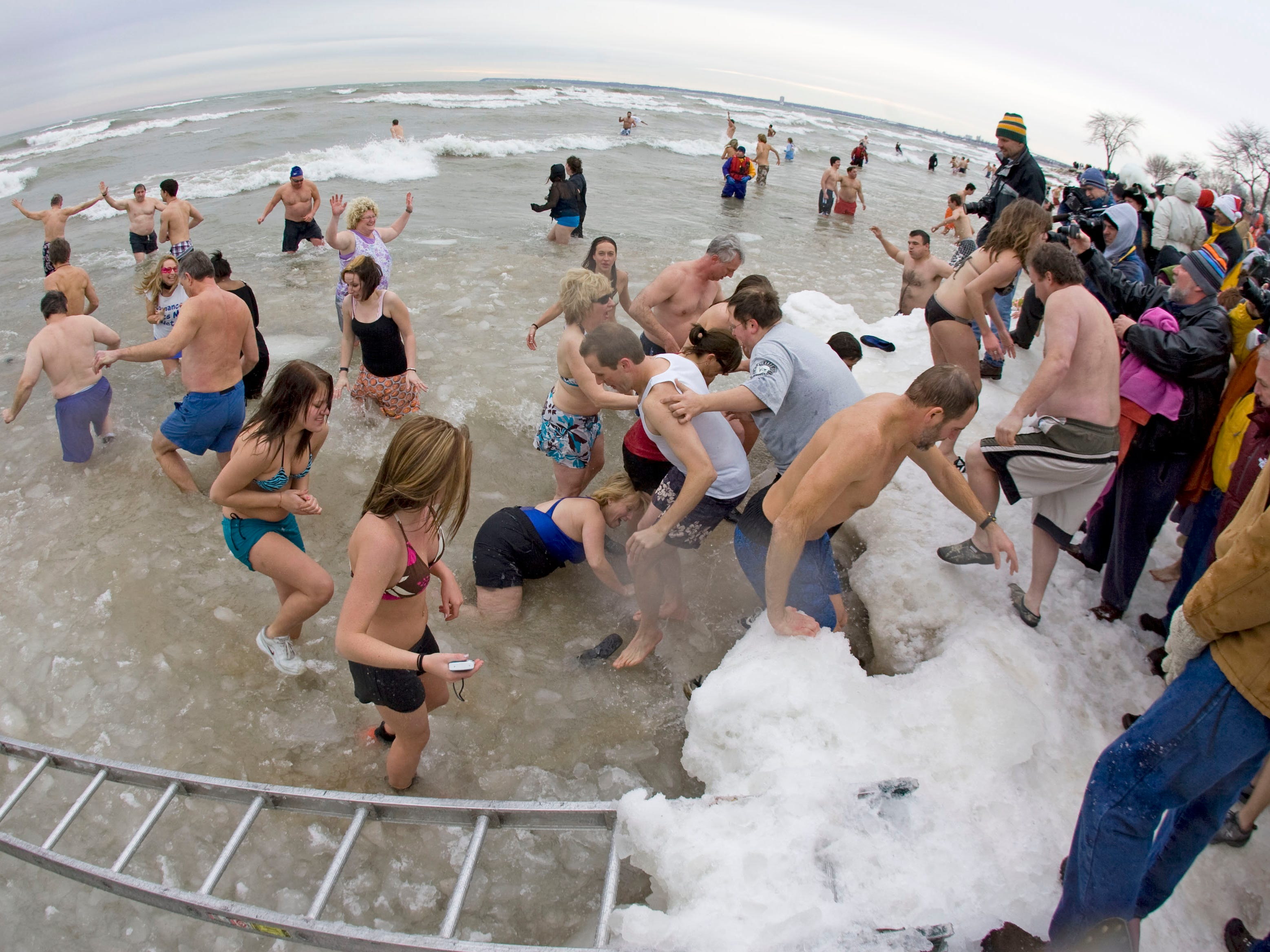 Polar Bears pour into the icy water at Bradford Beach for the 2009 Polar Bear Plunge on New Year's Day.
