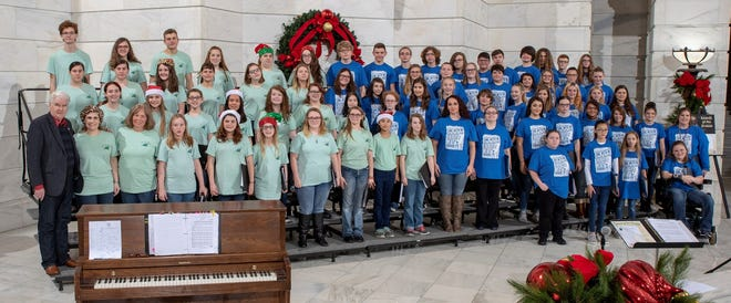 The combined school choirs of Yellville-Summit and Cotter sang in the Capitol Rotunda in Little Rock on Dec. 13. State RepresentativeJack Fortner and Mrs. Fortner were proud to host the choirs for lunch from Chick Fil-A and then on a tour of the beautiful state capitol building. Each school choir sang separately and then combined their voices to sing a Joy to the World medley. Congratulations to choir teachers Jennifer Lane of Yellville-Summit School and Susi Vangilder of Cotter School for a job well done. Pictured are both choirs, teachers and Rep. Fortner in the Capitol Rotunda.