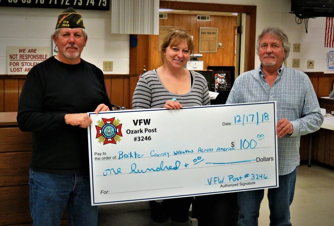 The Veterans of Foreign Wars Post 3246 in Mountain Home recentlycontributed $100 to purchase wreaths to place on the graves of area veterans as part of the Wreaths Across America program. Pictured are: (from left)Ronnie Young, commander of the Veterans of Foreign Wars Post 3246;Heather Duggins, coordinator of Baxter County Wreaths Across America; and Ric Bondy, post quartermaster.