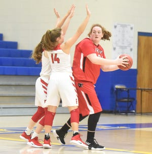 Norfork's Hannah Bryant passes out of a double team during the Lady Panthers' 61-50 victory over Farmington on Thursday.