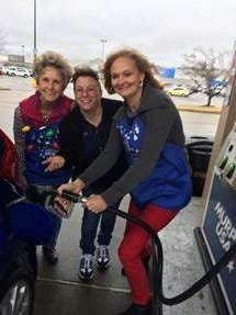 Arvest Bank associate Peggy Brown (from left) pumps and pays for gas for a customer at a local gas station, with assistance from Arvest Bank Mountain Home Market President Sally Gilbert. As part of the bank's Random Acts of Kindness Day, bank associates lend a hand to residents throughout the community during the holiday season.