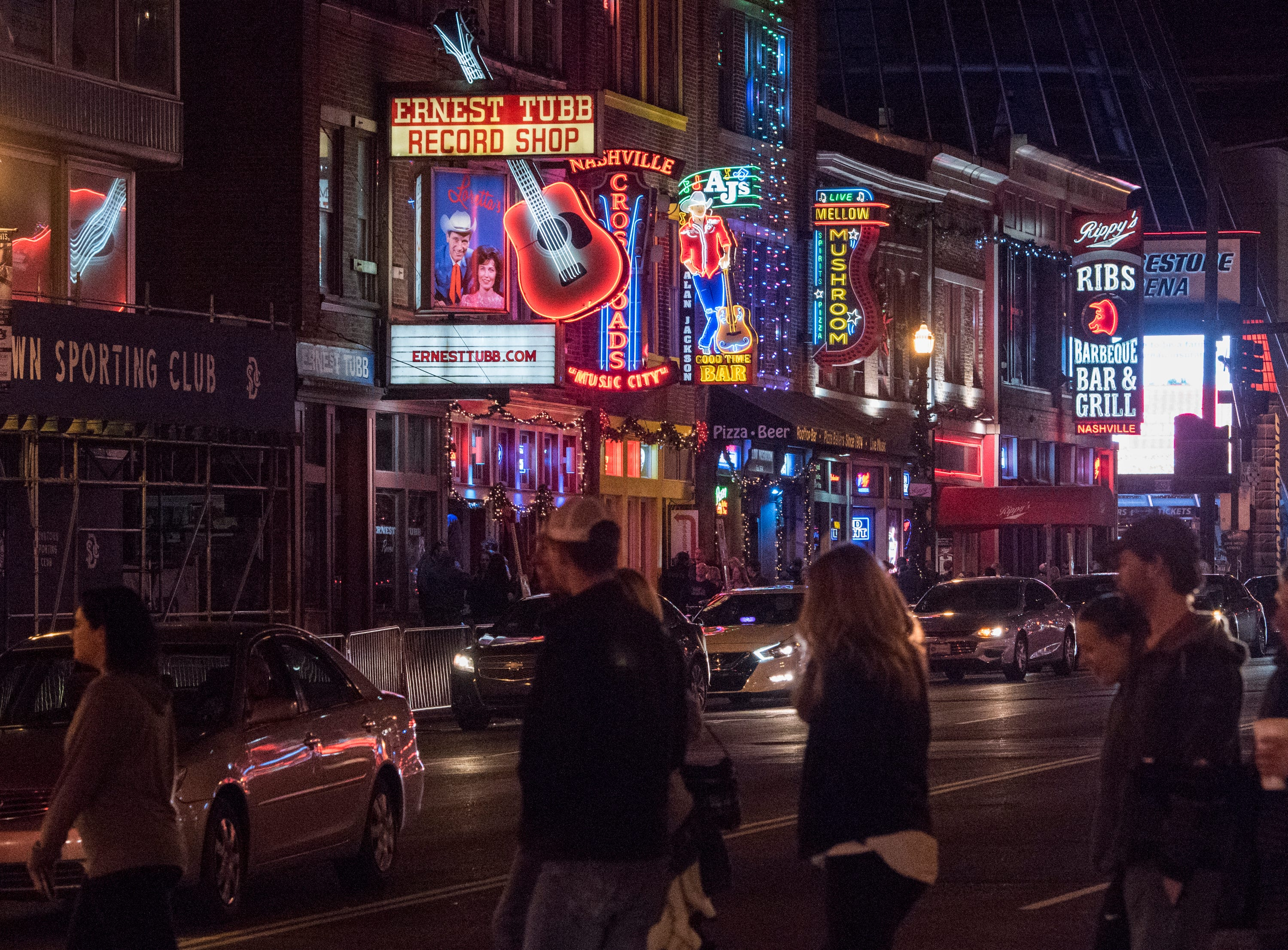 People walk around Broadway Street in Nashville, Ten., on Wednesday, Dec. 26, 2018. Auburn takes on Purdue in the Music City Bowl Friday.
