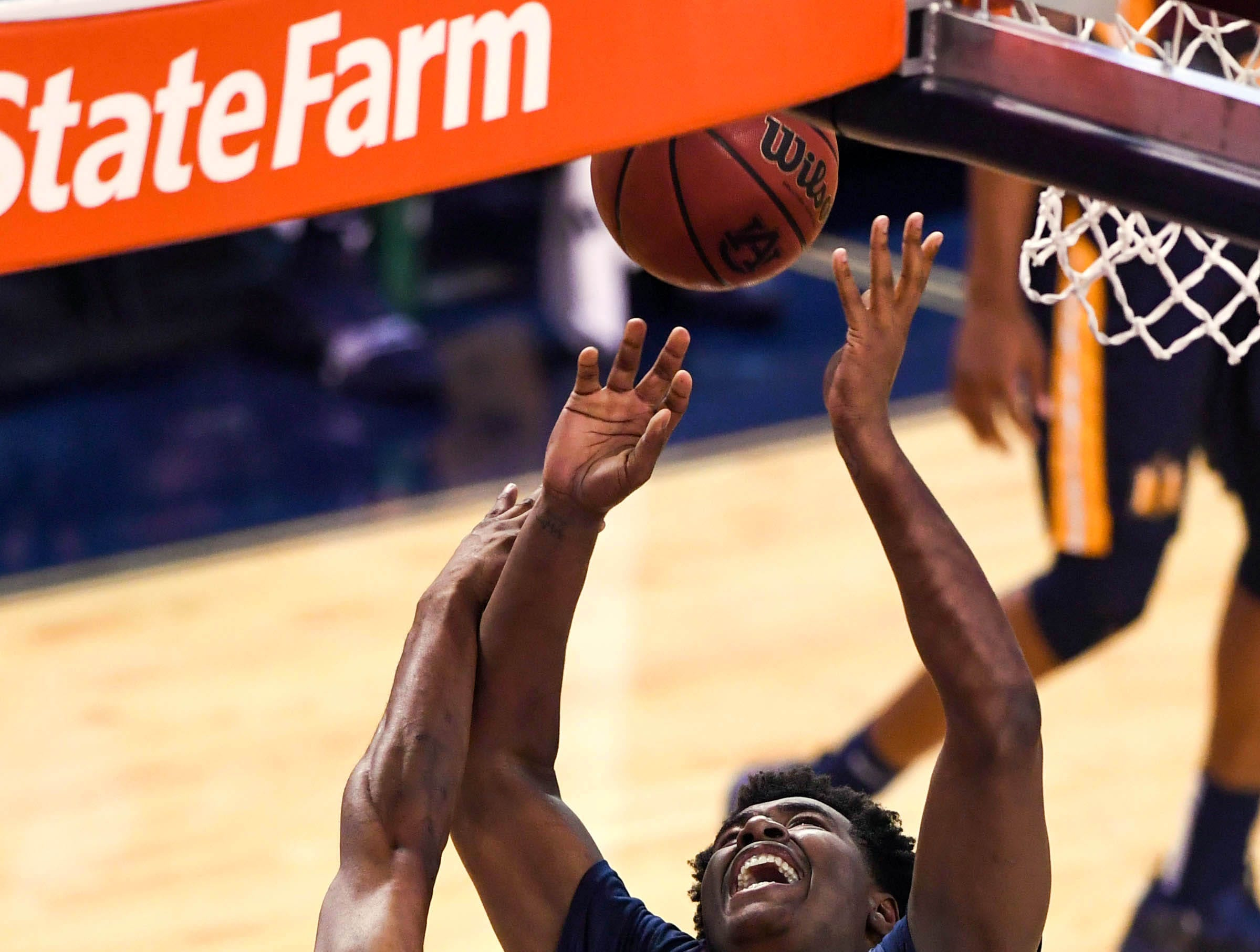 Dec 22, 2018; Auburn, AL, USA; Murray State Racers forward Darnell Cowart (32) goes up for a shot as Auburn Tigers forward Horace Spencer (0) defends during the second half at Auburn Arena. Mandatory Credit: Shanna Lockwood-USA TODAY Sports