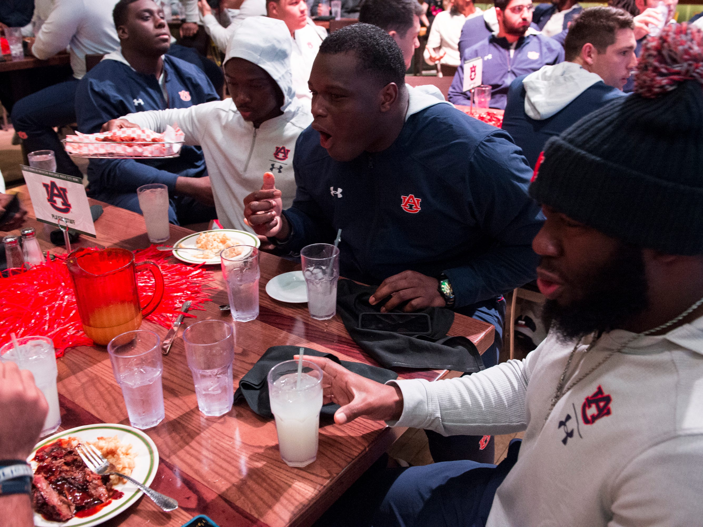 Auburn players react after eating Nashville Hot Chicken at Wild Horse Saloon in Nashville, Ten., on Wednesday, Dec. 26, 2018. Auburn takes on Purdue in the Music City Bowl Friday.