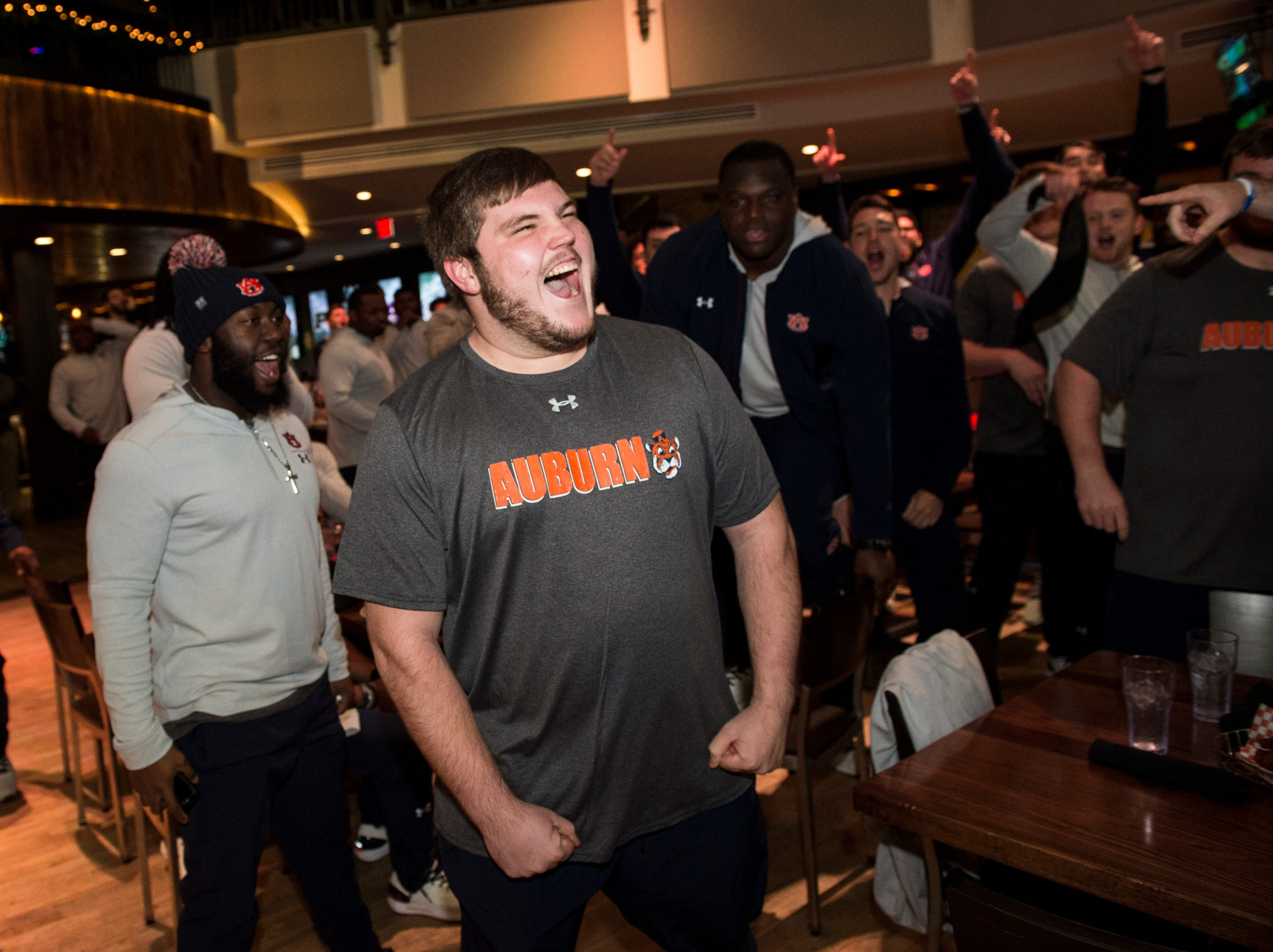 Auburn offensive lineman Peyton Nance (63) gets pumped up for the hot chicken eating competition at Wild Horse Saloon in Nashville, Ten., on Wednesday, Dec. 26, 2018. Auburn takes on Purdue in the Music City Bowl Friday.