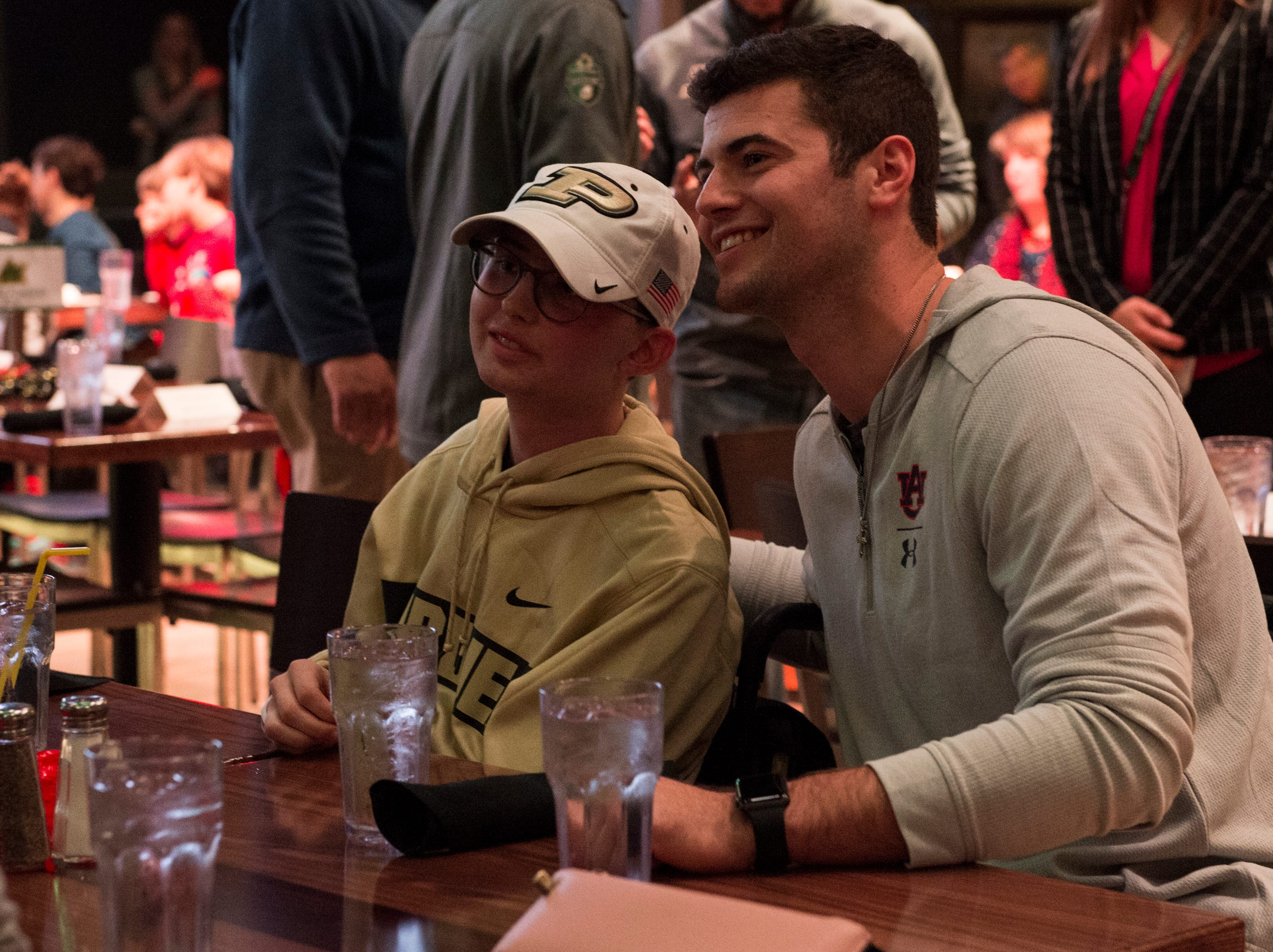Auburn quarterback Jarrett Stidham (8) poses for a picture with Tyler Trent at Wild Horse Saloon in Nashville, Ten., on Wednesday, Dec. 26, 2018. Trent is a former Purdue student and Boilermaker fan who is suffering from a rare form of bone cancer. Auburn takes on Purdue in the Music City Bowl Friday.
