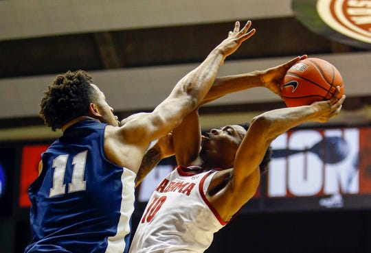 Dec 21, 2018; Tuscaloosa, AL, USA; Alabama Crimson Tide guard Herbert Jones (10) shoots the ball as Penn State Nittany Lions forward Lamar Stevens (11) defends during the second half of an NCAA college basketball game at Coleman Coliseum. Mandatory Credit: Butch Dill-USA TODAY Sports