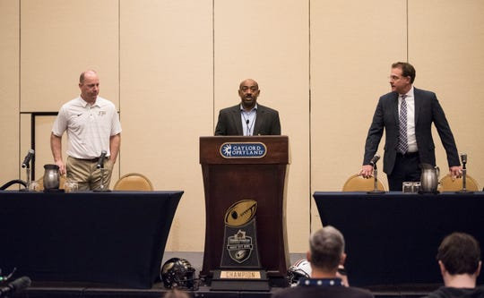 Purdue head coach Jeff Brohm and Auburn head coach Gus Malzahn take their seats during a press conference at Gaylord Opryland in Nashville, Ten., on Thursday, Dec. 27, 2018. Auburn takes on Purdue in the Music City Bowl on Friday.