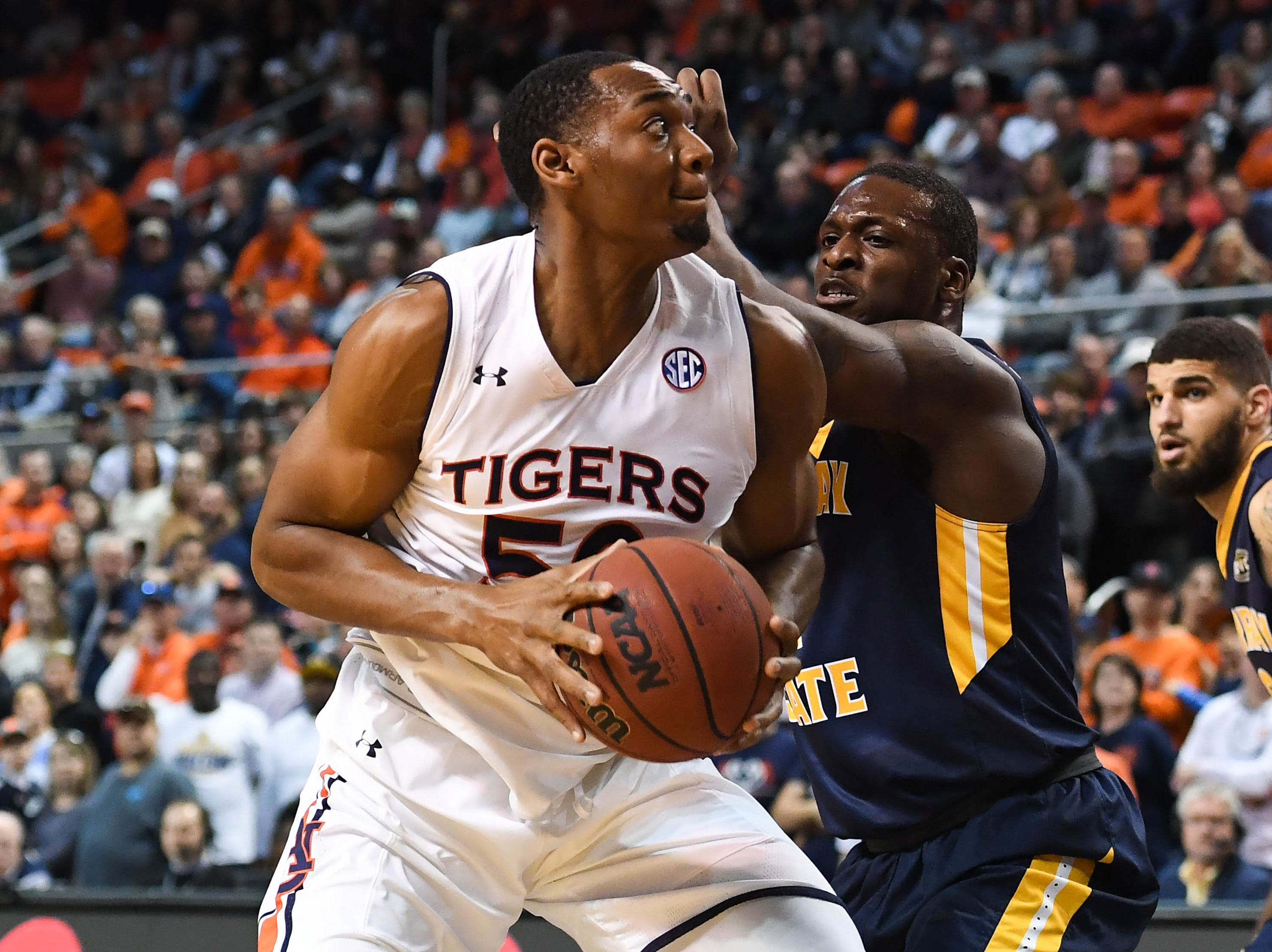Dec 22, 2018; Auburn, AL, USA; Auburn Tigers center Austin Wiley (50) is defended by Murray State Racers forward Brion Sanchious (4) during the first half at Auburn Arena. Mandatory Credit: Shanna Lockwood-USA TODAY Sports