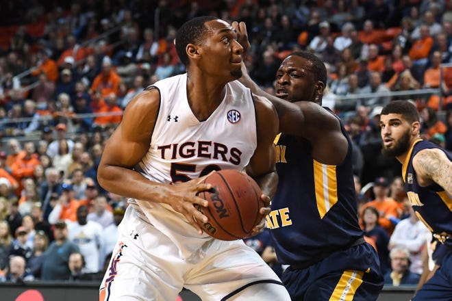 Auburn center Austin Wiley (50) is defended by Murray State forward Brion Sanchious (4) during a game at Auburn Arena on Dec. 22, 2018.