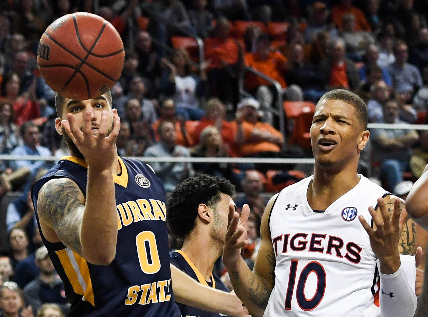 Dec 22, 2018; Auburn, AL, USA; Murray State Racers forward Mike Davis (0) goes for a rebound as Auburn Tigers guard Samir Doughty (10) reacts during the second half at Auburn Arena. Mandatory Credit: Shanna Lockwood-USA TODAY Sports