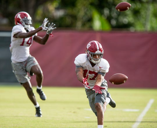 Alabama wide receiver Jaylen Waddle (17) and Alabama wide receiver Tyrell Shavers (14) catch passes during Alabama's practice on the Barry University campus in Miami Shores, Fla., on Thursday December 27, 2018. Alabama plays Oklahoma in the Orange Bowl on Saturday.