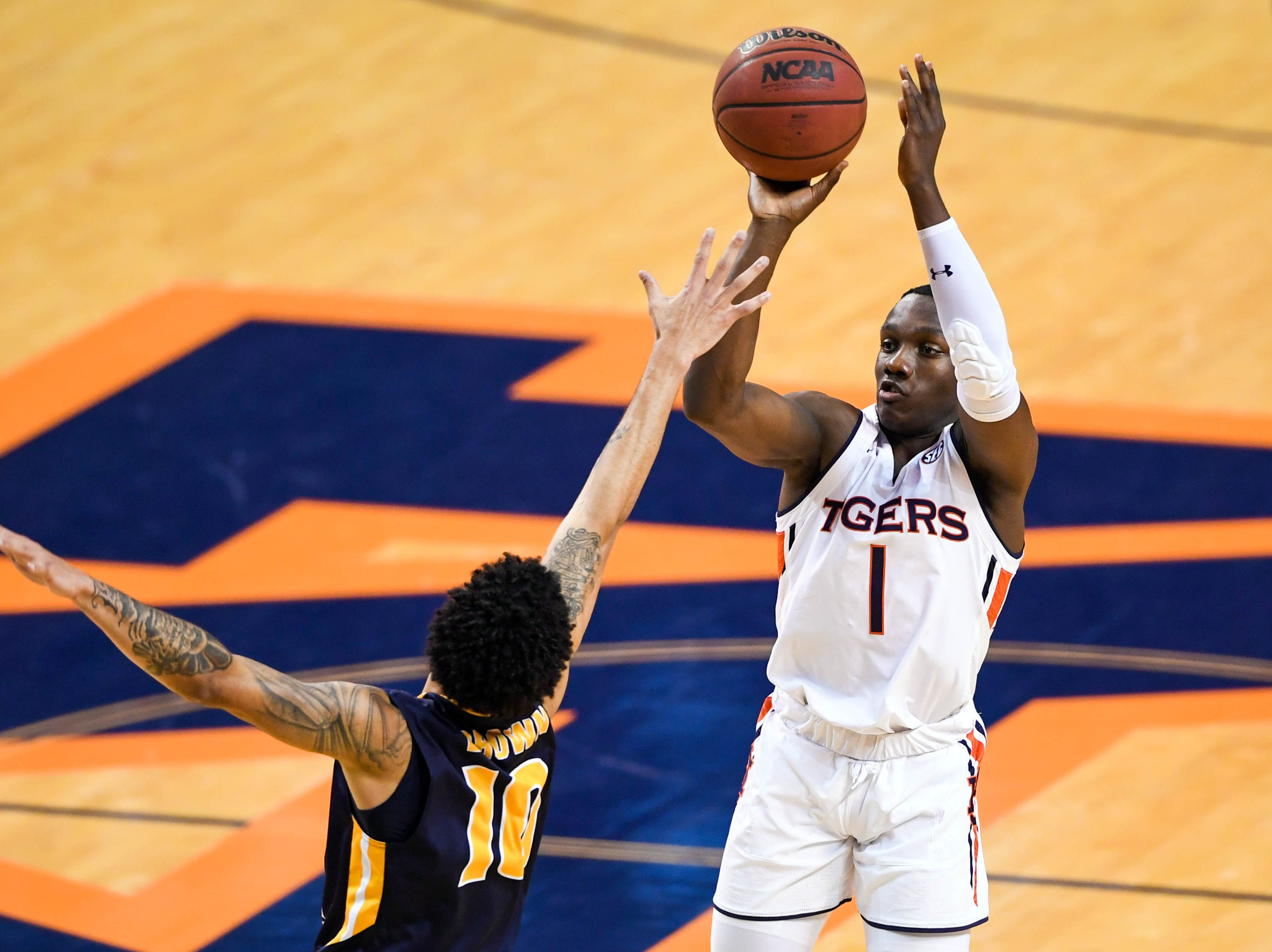 Dec 22, 2018; Auburn, AL, USA; Auburn Tigers guard Jared Harper (1) shoots over Murray State Racers guard Tevin Brown (10) during the second half at Auburn Arena. Mandatory Credit: Shanna Lockwood-USA TODAY Sports