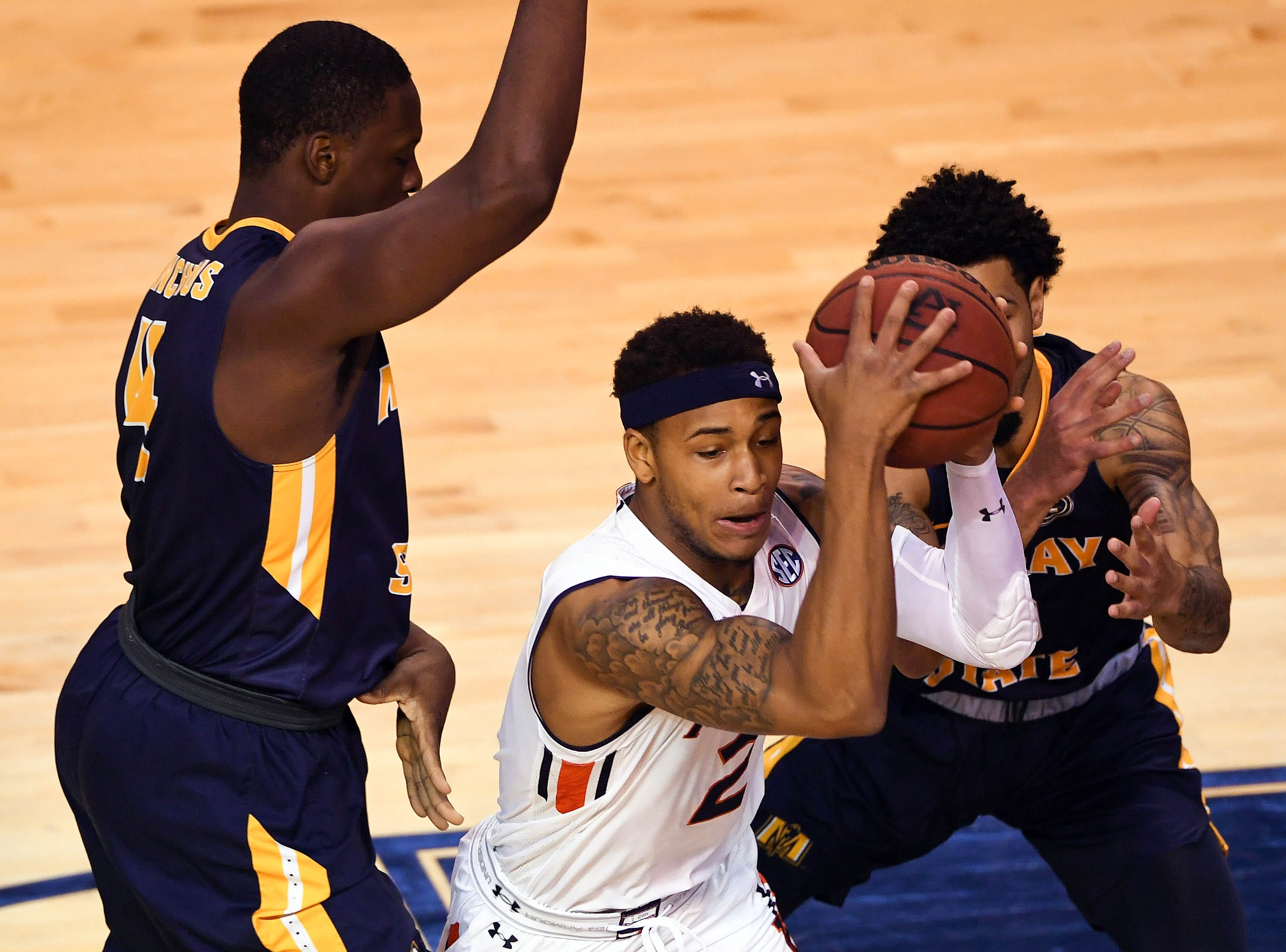 Dec 22, 2018; Auburn, AL, USA; Auburn Tigers guard Bryce Brown (2) is defended by Murray State Racers forward Brion Sanchious (4) and guard Tevin Brown (background) during the first half at Auburn Arena. Mandatory Credit: Shanna Lockwood-USA TODAY Sports