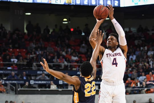 Dec 22, 2018; Auburn, AL, USA; Auburn Tigers guard Malik Dunbar (4) shoots over Murray State Racers guard Brion Whitley (22) during the first half at Auburn Arena. Mandatory Credit: Shanna Lockwood-USA TODAY Sports