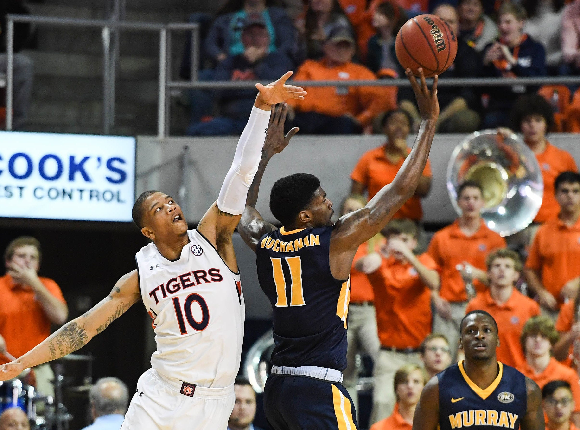 Dec 22, 2018; Auburn, AL, USA; Murray State Racers guard Shaq Buchanan (11) shoots as Auburn Tigers guard Samir Doughty (10) defends during the second half at Auburn Arena. Mandatory Credit: Shanna Lockwood-USA TODAY Sports