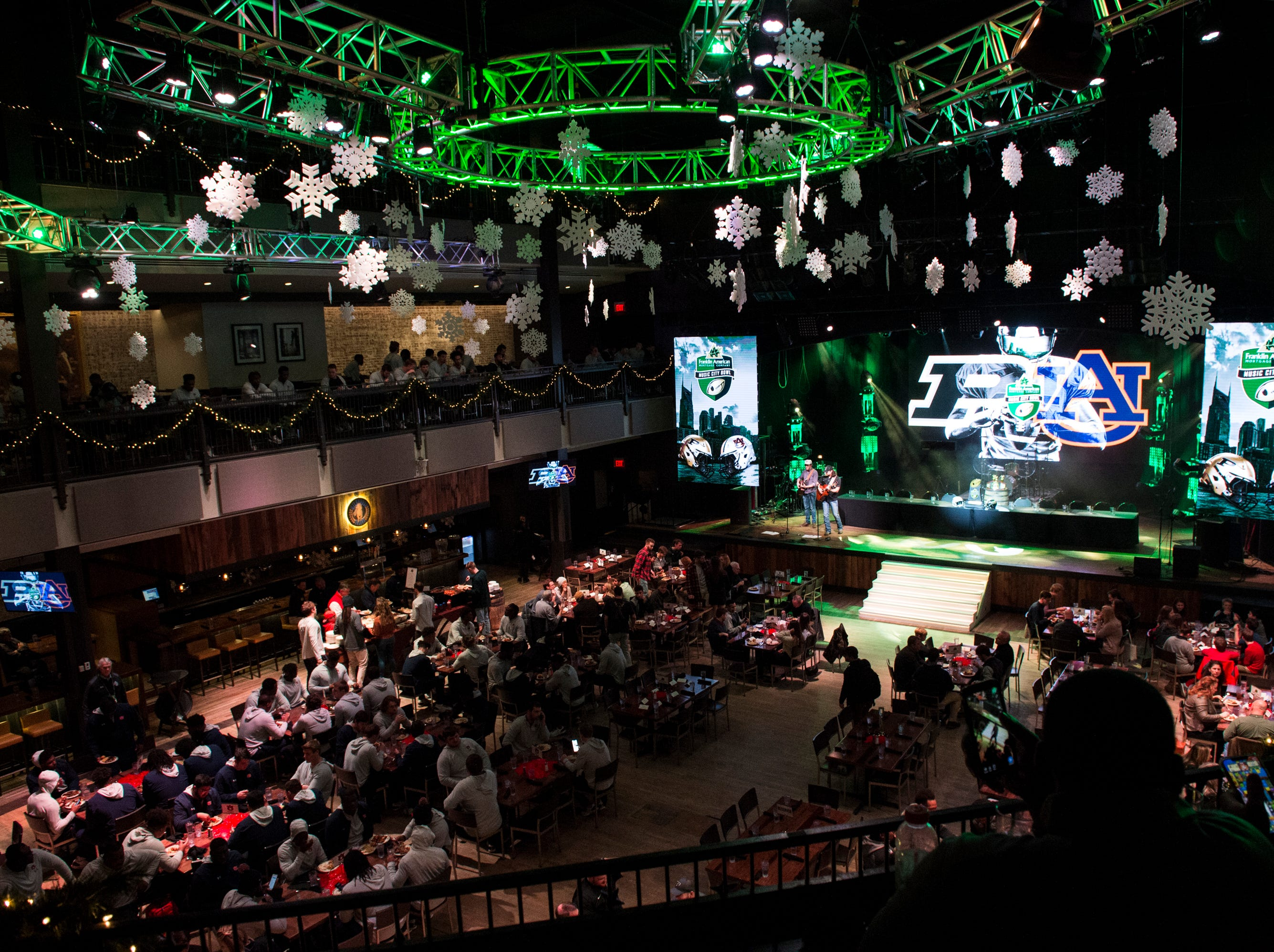 Teams eat and entertain together at Wild Horse Saloon in Nashville, Ten., on Wednesday, Dec. 26, 2018. Auburn takes on Purdue in the Music City Bowl Friday.