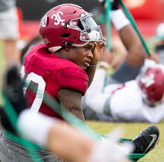 Alabama linebacker Mack Wilson (30) stretches during Alabama's practice on the Barry University campus in Miami Shores, Fla., on Thursday December 27, 2018.