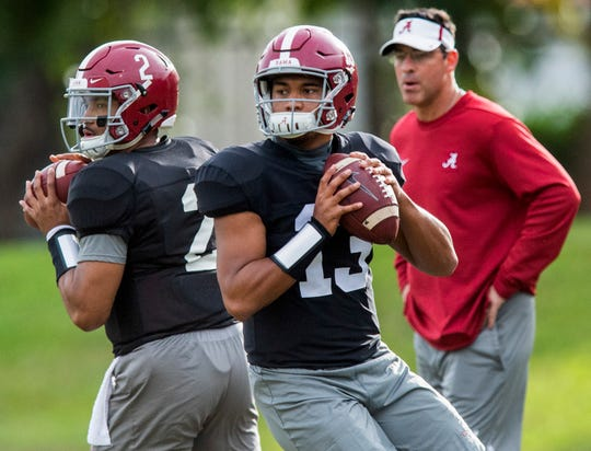 Alabama quarterbacks Jalen Hurts (2) and Tua Tagovailoa (13) warm up as Alabama quarterbacks coach Dan Enos looks on during Alabama's practice on the Barry University campus in Miami Shores, Fla., on Thursday December 27, 2018. Alabama plays Oklahoma in the Orange Bowl on Saturday.