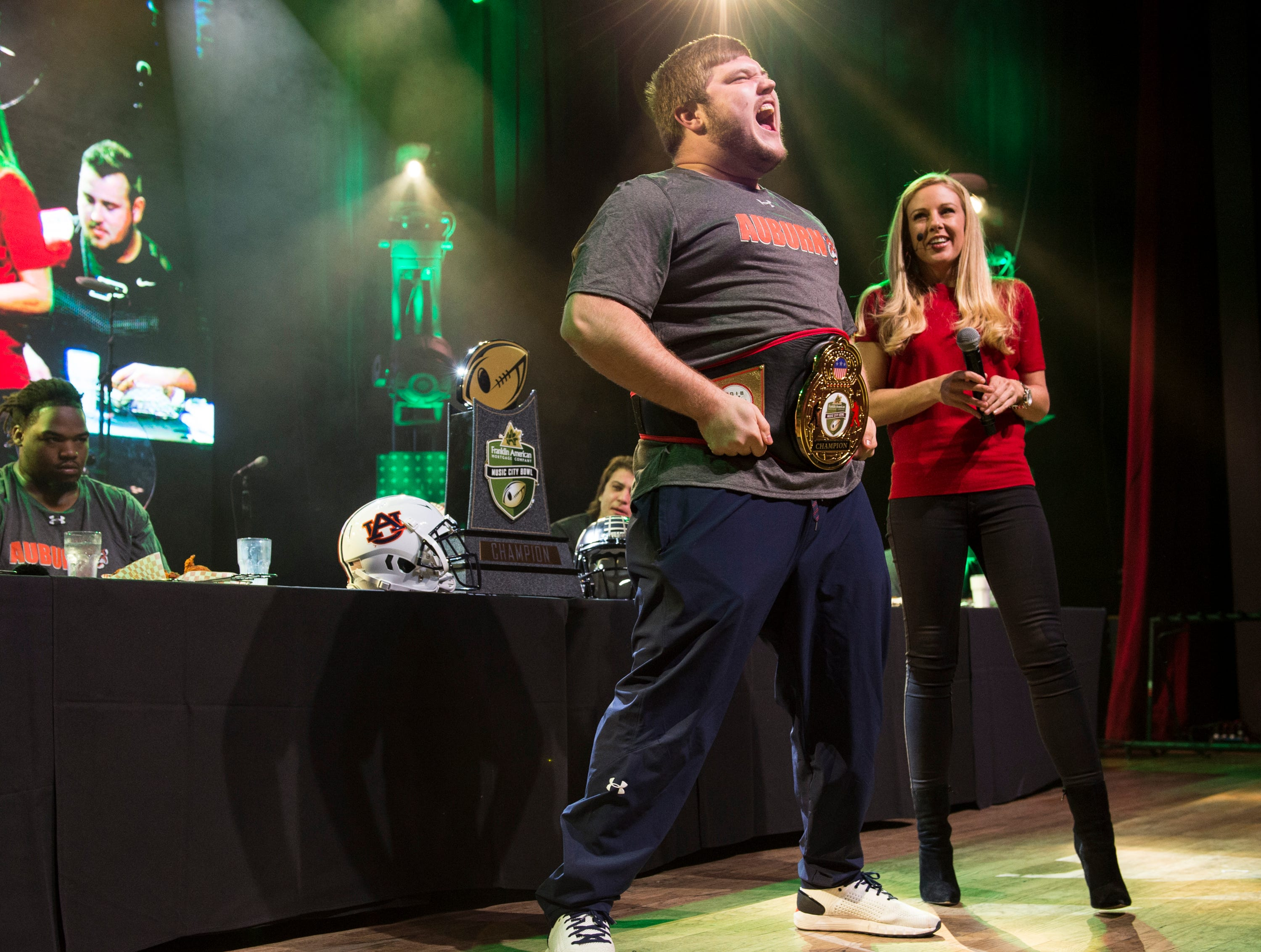 Auburn offensive lineman Peyton Nance (63) reacts after winning the hot chicken eating competition after eating 14 wings in four minutes at Wild Horse Saloon in Nashville, Ten., on Wednesday, Dec. 26, 2018.