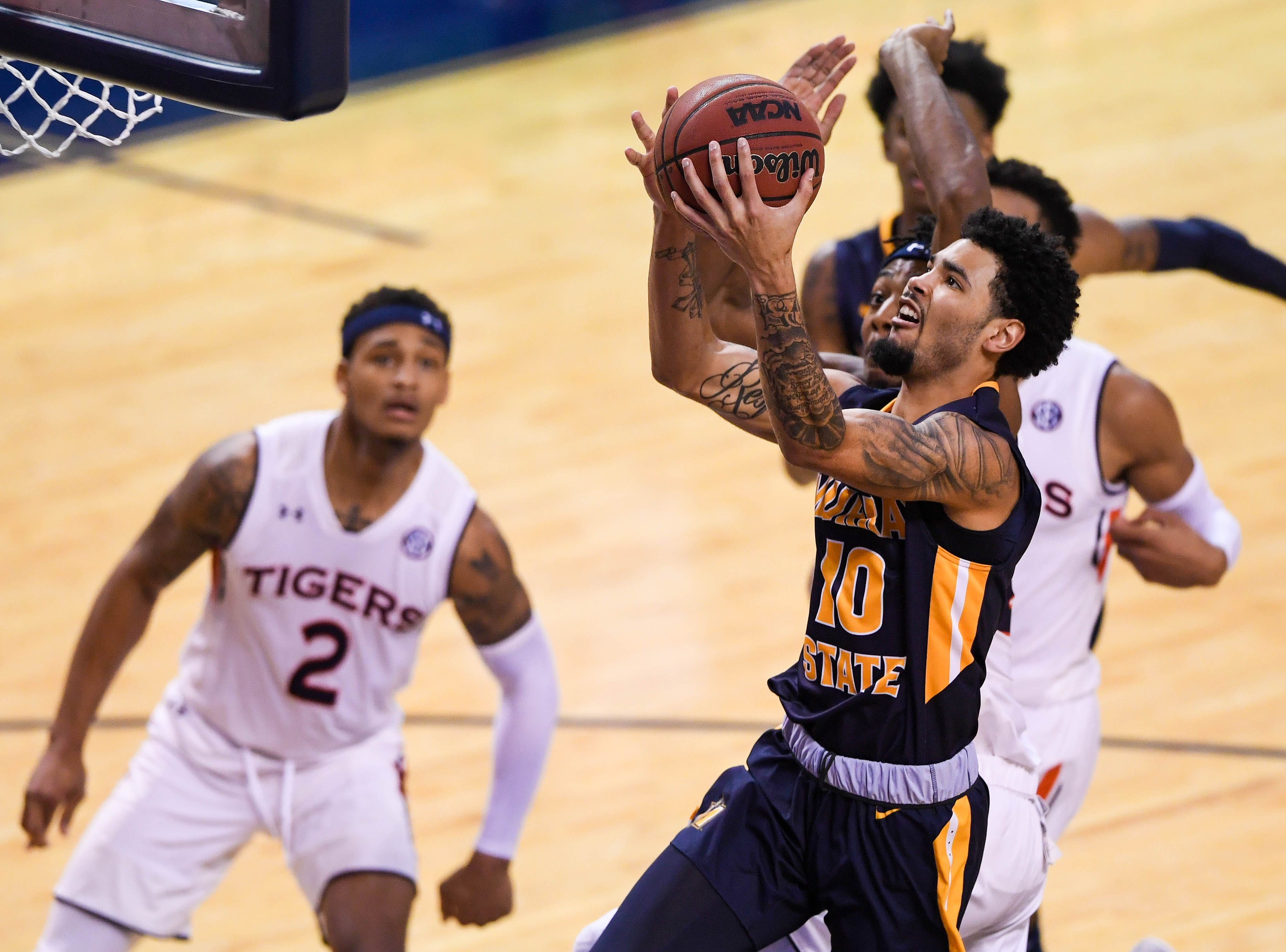 Dec 22, 2018; Auburn, AL, USA; Murray State Racers guard Tevin Brown (10) goes up for a shot as Auburn Tigers guard Bryce Brown (2) looks on during the second half at Auburn Arena. Mandatory Credit: Shanna Lockwood-USA TODAY Sports