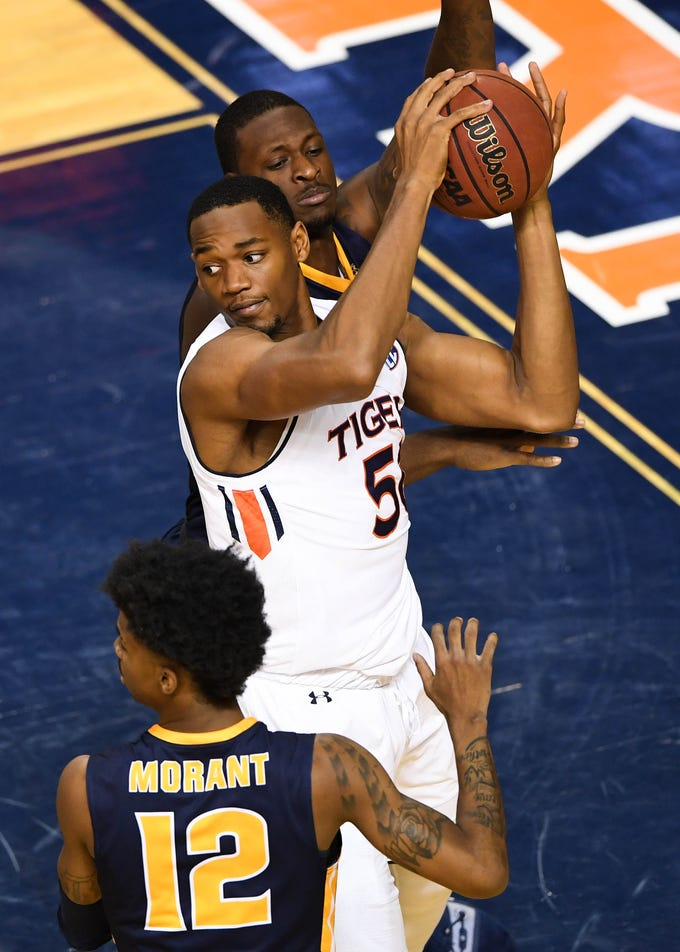 Dec 22, 2018; Auburn, AL, USA; Auburn Tigers center Austin Wiley (50) is defended by Murray State Racers guard Ja Morant (12) during the first half at Auburn Arena. Mandatory Credit: Shanna Lockwood-USA TODAY Sports