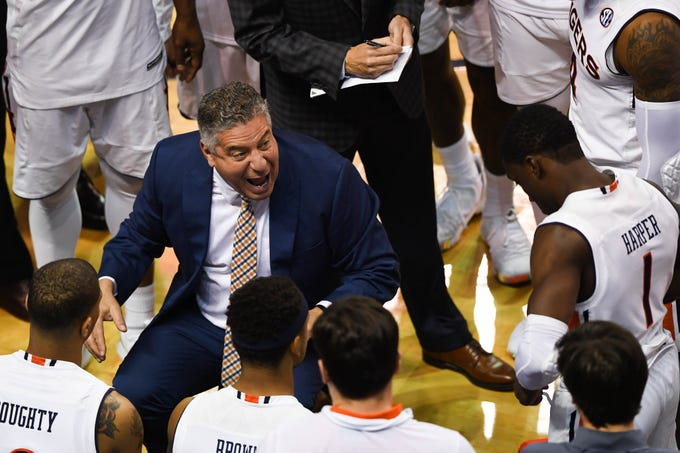 Auburn coach Bruce Pearl speaks to his players during the first half against Murray State at Auburn Arena on Dec. 22, 2018.