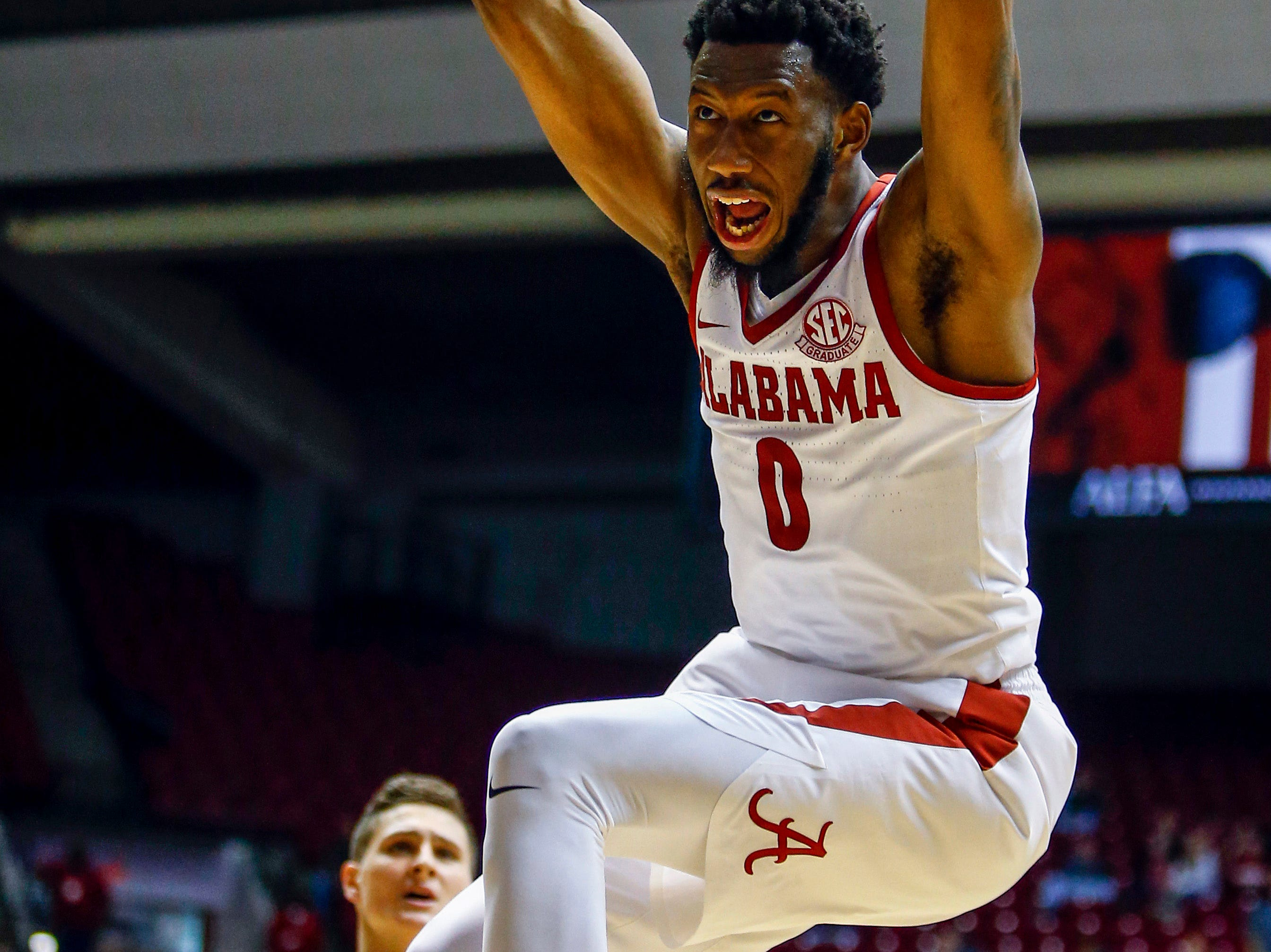 Dec 21, 2018; Tuscaloosa, AL, USA; Alabama Crimson Tide forward Donta Hall (0) dunks the ball during the second half of an NCAA college basketball game against the Penn State Nittany Lions at Coleman Coliseum. Mandatory Credit: Butch Dill-USA TODAY Sports