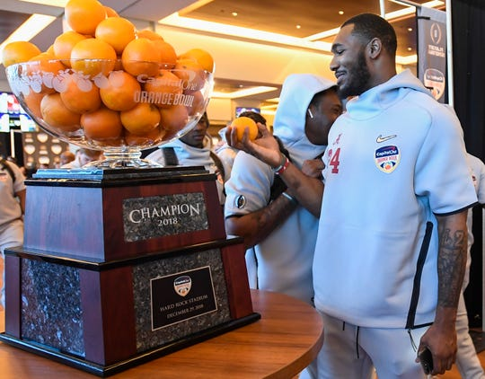Alabama linebacker Terrell Lewis (24) checks out the oranges in the Orange Bowl trophy during the Alabama Media Day at the Hard Rock Stadium in Miami Gardens, Fla., on Wednesday December 26, 2018.
