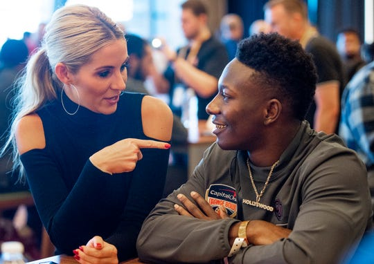 ESPN's Laura Rutledge interviews Oklahoma wide receiver Marquise Brown (5) during the Oklahoma Media Day at the Hard Rock Stadium in Miami Gardens, Fla., on Wednesday December 26, 2018.