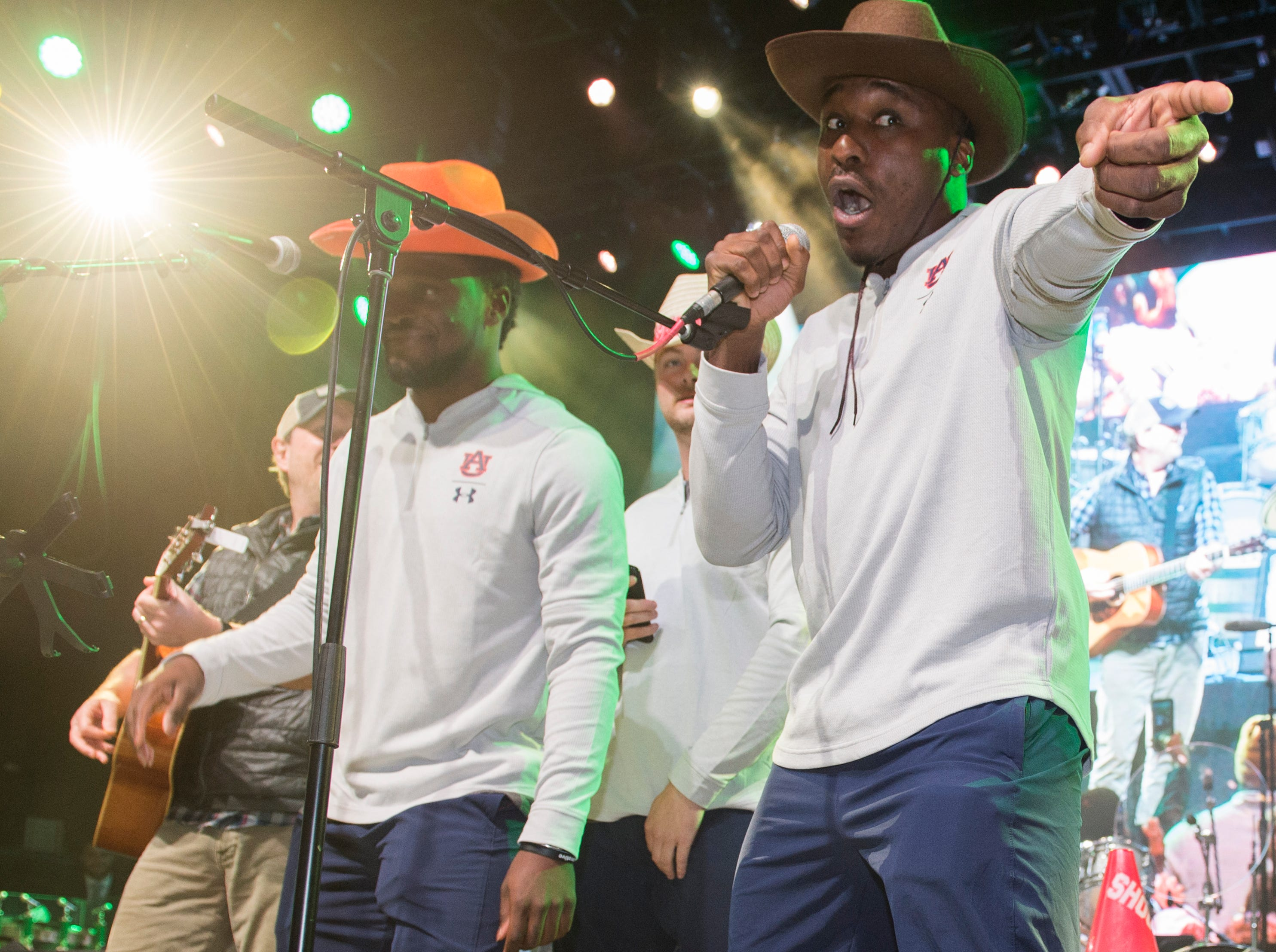 Auburn players sing with singer/songwriter Jim Beavers during a singing competition at Wild Horse Saloon in Nashville, Ten., on Wednesday, Dec. 26, 2018. Auburn takes on Purdue in the Music City Bowl Friday.
