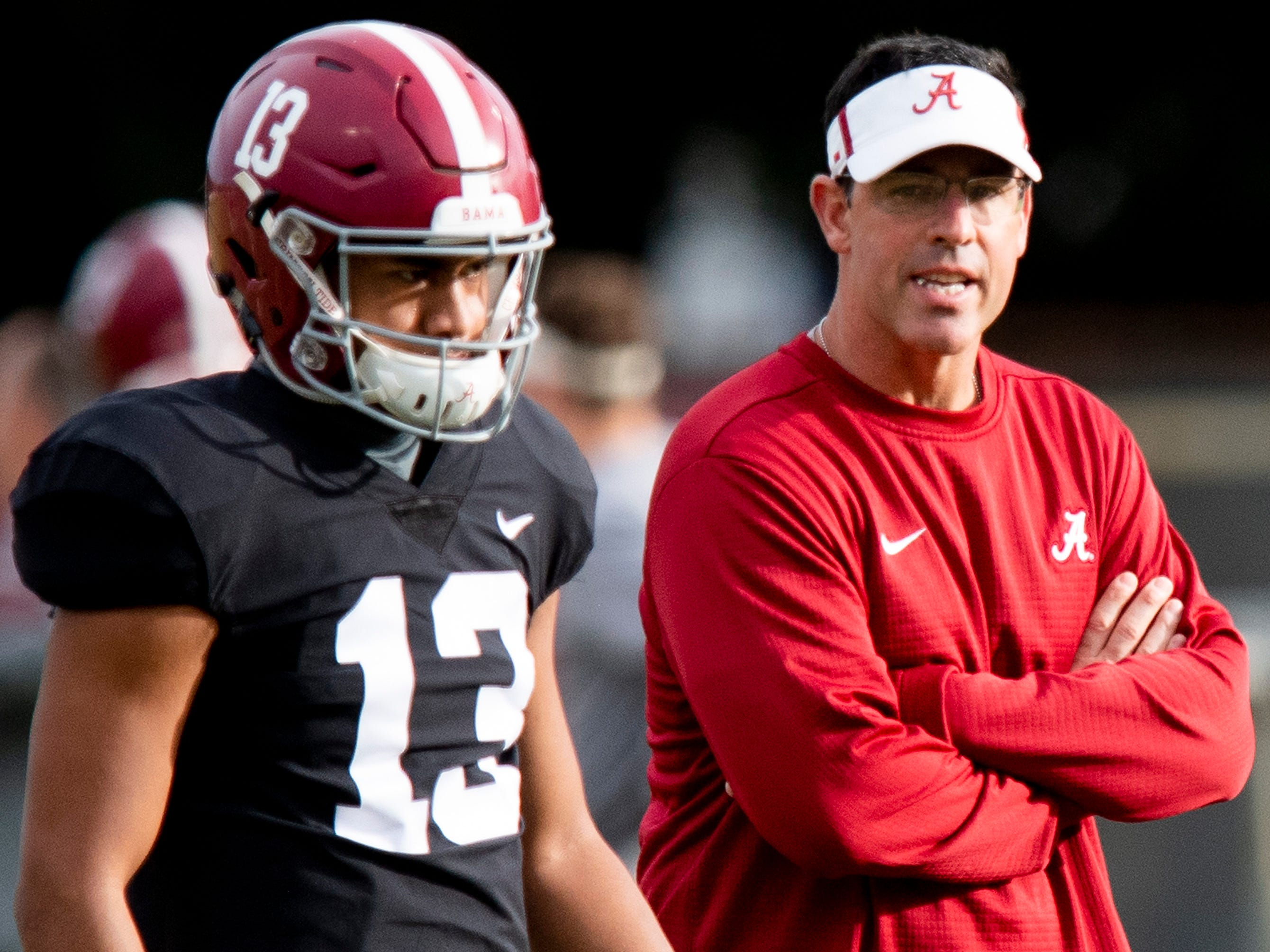 Alabama quarterbacks coach Dan Enos talks with quarterback Tua Tagovailoa (13) during Alabama's practice on the Barry University campus in Miami Shores, Fla., on Thursday December 27, 2018. Alabama plays Oklahoma in the Orange Bowl on Saturday.