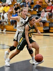 Beaver Dam High School's Jada Donaldson (13) drives the paint around a Plant High School defender during the Naples Holiday Shootout at Gulf Coast High School in Naples on Thursday.