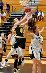 Beaver Dam High School's Tara Stauffacher (40) takes the ball to rim in their game with Plant High School during the Naples Holiday Shootout at Gulf Coast High School in Naples on Thursday.