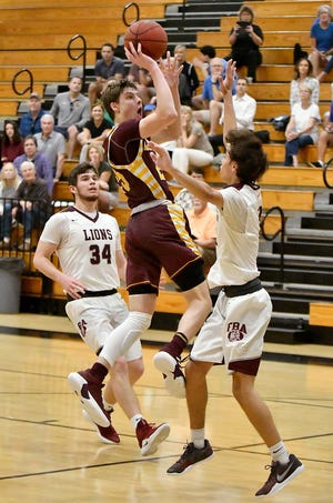 Loyola High School's Connor Barrett (25) drives the ball to the basket during their game with First Baptist Academy in the Kelleher Firm Gulfshore Holiday Hoopfest at Golden Gate High School on Thursday.