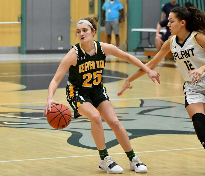 Beaver Dam High School's Maty Wilke (25) pushes the ball up court while defended by Plant High School during the Naples Holiday Shootout at Gulf Coast High School in Naples on Thursday.