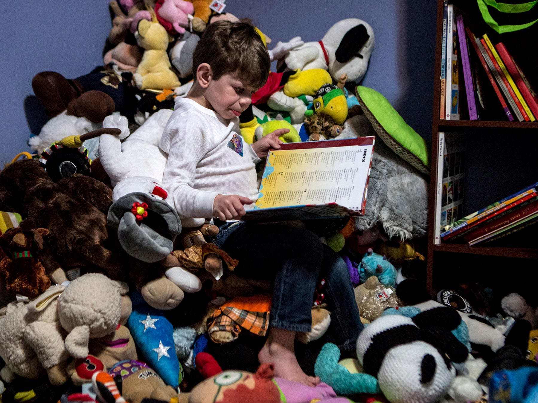 After being thrown onto a pile of stuffed animals Leo grabbed a book and started flipping through the pages. Leo, who is 6, has been diagnosed with Williams Syndrome and Autism meaning he sometimes fixates on a certain thing, like a book for an extended period of time.