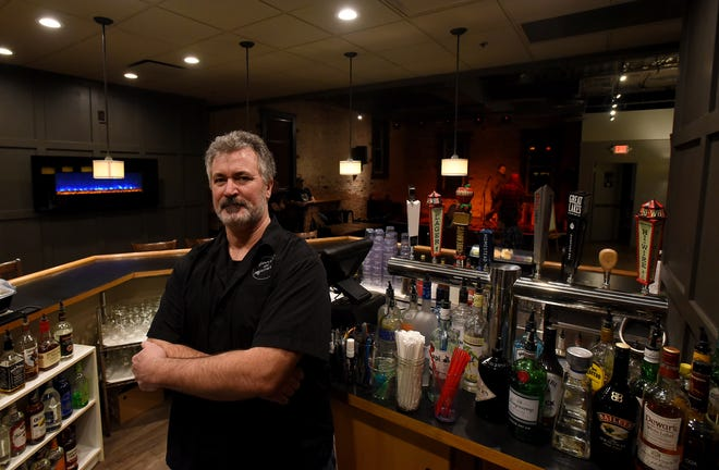 """Greg """"Sonny"""" O'Bryan, general manager of Sonny's on Broadway, behind the bar of the Granville music venue located downtown. The venue has a full-service bar with 8 taps and a full menu of spirits and wine. Food can be ordered from the Donatos menu and enjoyed upstairs during shows."""