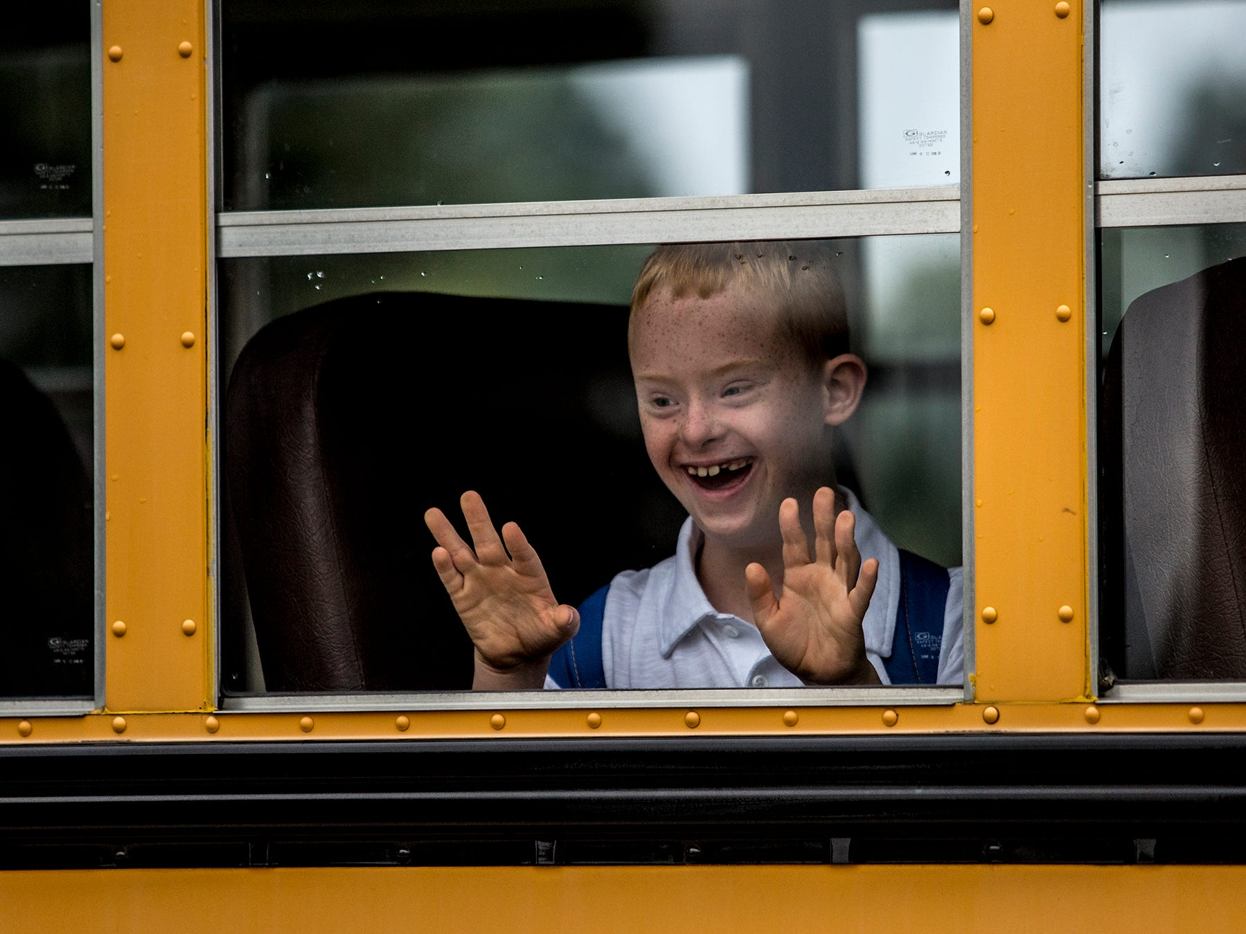 McGuffey 3rd grader, Shane Evans breaks into a huge smile as he sees his teachers waiting to greet him for the first day of school.